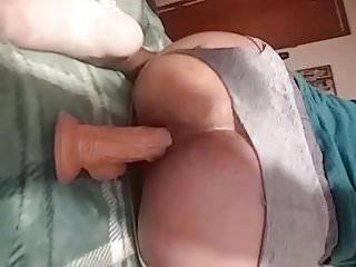 Riding my uncut rubber cock