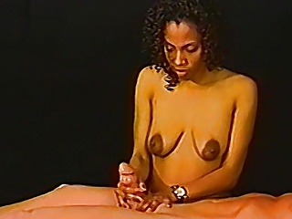 Amateur Interracial Handjobs video: Ebony amateur jerking a white cock