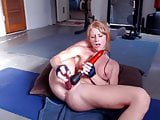 ginger girl with fit body plays with toys on webcam
