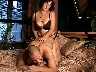 Anal Amateur video: Girlfriend fucking him with a strapon on bed