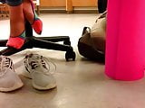 Teen school girl takes her shoes off after gym class