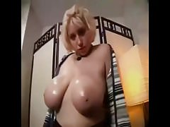 Busty amateur jiggling and oiling her tits :P