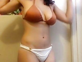 Sister strips on camera with brother