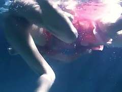 Two hot lesbians underwater touching eachother
