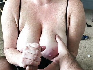 Handjob Redhead Cumshot video: Cumming on freckled tits