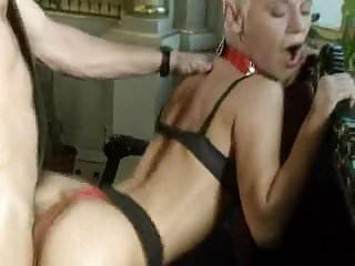 .beautiful short-haired Olga Pechova as a hot dominatrix.
