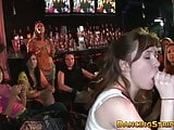 Amateur babes devouring big cock at a strip club