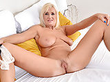 Blonde older woman rubbing her pussy