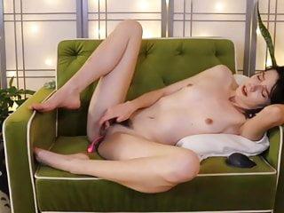Cute skinny short hair brunette masturbates in sofa to XTC.