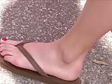 Cute girls' feet at street festival
