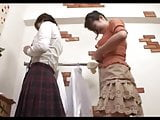 Japanese mother and daughter undressing