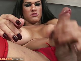 Brunette tranny in red corset jerks off til massive cumshot