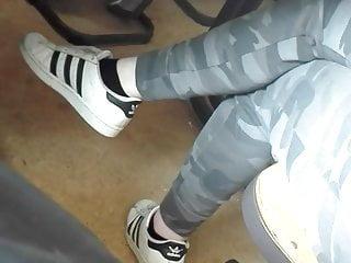 Cute Teen dangling her feet in black sneaker Socks