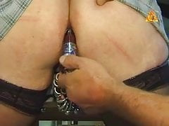 Extremley pierced MILF with heavy pussy rings bottle in ass