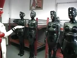 .Submissive lesbian slut anal inflatation in latex black body.