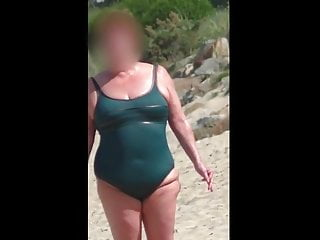 Amateur Bbw Hidden Cams video: chubby mature in the wet green swimsuit