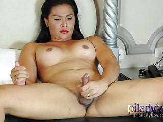 Cute Chubby Pi Ladyboy cumming on hands