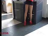 Girl in extremely short skirt and high heels