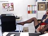 Mature office slut wanks herself off at her desk