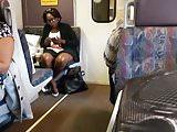 Ebony milf brown shiny legs on the train