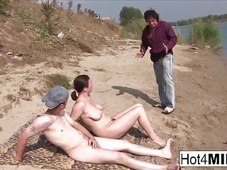 Outdoor Milf Cumshot video: Busty MILF with natural tits fucks on the beach