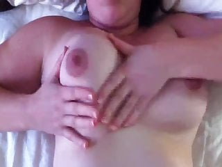 Squeezing her big tits