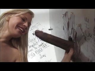 Blondie sucking bbc in a gloryhole