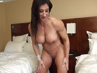 Muscular female bodybuilder shows her and big clit...