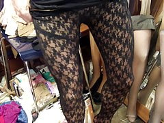 Dressing up, lace pantyhose over shiny pantyhose in natural