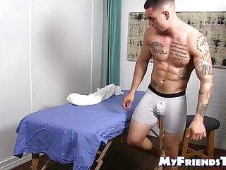 Handsome tattooed jock feet massaged by hunky gay
