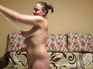 Stupid slut stretches her ugly saggy tits hard...