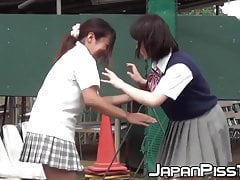Naughty Japanese schoolgirls pissing in secret public place