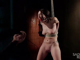 Hot petite slut in brutal bondage with devastating...
