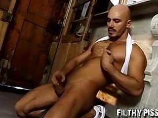 Hunk ends up leaking pee out of his dick and stroking it too