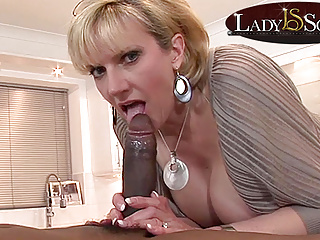 Mature gets a mouthful of big black cock...