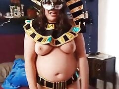 Egyptian Goddess does striptease and shows big clit
