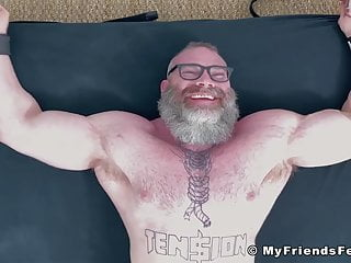 Bearded huge hunk with glasses tickle tormented by his dom