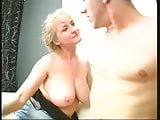Busty blonde gets her  terrific boobs sensuously sucked
