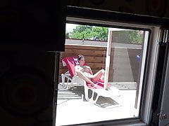 Spy my hot neighbor woman while she tan her beautiful body.
