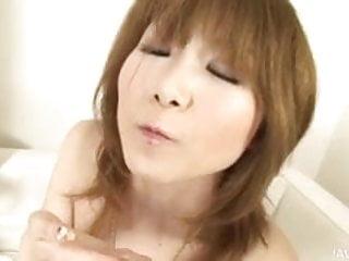 Raunchy Rika Sakurai toys both her holes at the same time