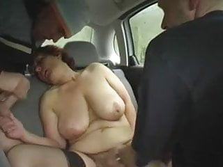 Redhead granny outdoors in a car by 2...