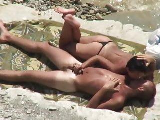 Woman in thong bikini initiates...