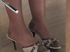 Milf teasing in nylons under table