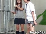 Two girls get caught pissing and filming each other outside