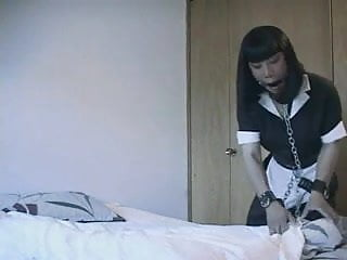 Housekeeping maid in chains