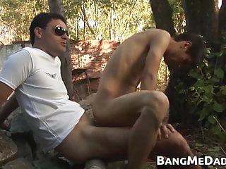 Latinos Alejo and Antonio bareback outdoors after blowjob