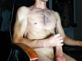 Sporty guy jerks off a big cock