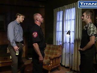 Masculine cop makes blow him...