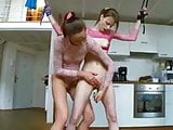 Young lesbian bound and kinky playing with glass dildo