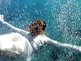 Swimming gracefully naked underwater